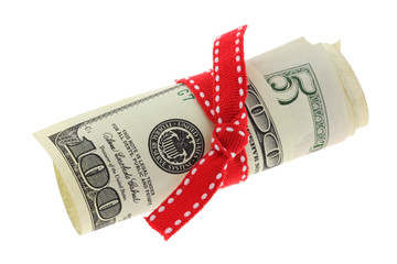 Rolled Dollar banknote with a red ribbon bow