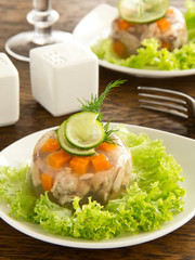 meat jelly with vegetables and sauce.