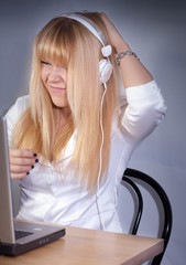 attractive blond girl enjoys digital music on headphones