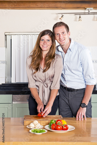 Business couple in kitchen