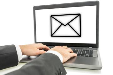 Businessman sending email