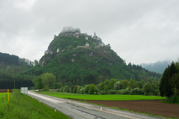 Landscape of rural Austria and road to the old castle on hill