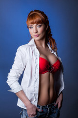 Portrait of seductive red-haired slender woman