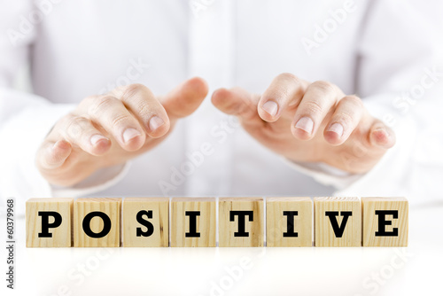 Man holding his hands over the word Positive