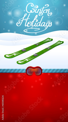winter holidays green skiing and red ski goggles