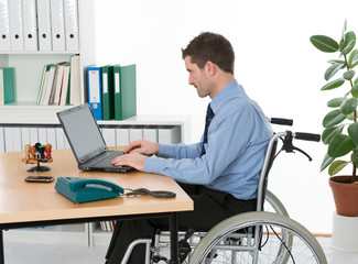man in wheelchair on his workplace