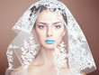 Fashion photo of beautiful women under white veil