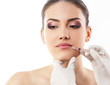 lips injections, beautiful young female face with beauty treatme