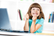 Excited little girl with laptop