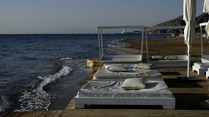 Relaxing facilities on a beach of the Red Sea, Eilat, Israel
