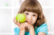 Beautiful little girl with apple