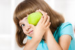 Little girl with apple