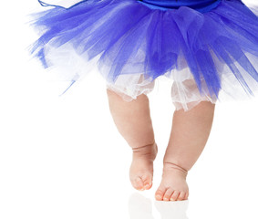 baby girl like a ballet dancer in blue tutu, isolated on white