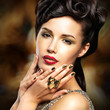 Beautiful  woman with golded nails and red lips