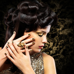 Beautiful  woman with golden nails