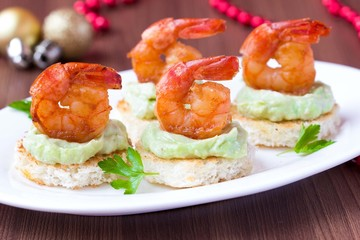 Shrimp on toast with guacamole sauce, Christmas appetizer