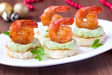 Shrimp on toast with guacamole sauce, Christmas appetizer