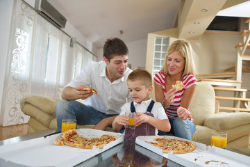 family eating pizza