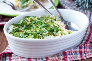Rice casserole with egg, green spring onions, cilantro, chili
