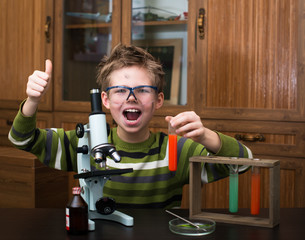 Happy boy making science experiments. Education.
