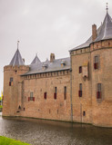 View on Muiderslot Castle in the Netherlands under a cloudy sky