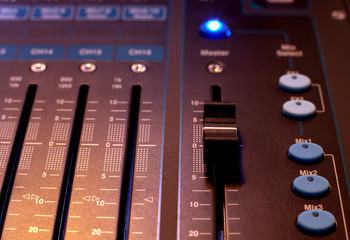 sound studio adjusting record equipment