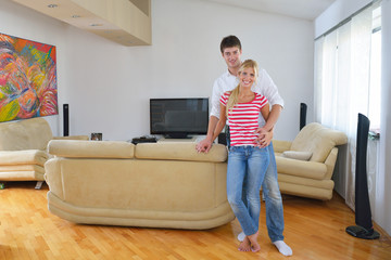 Relaxed young  couple watching tv at home