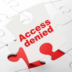 Protection concept: Access Denied on puzzle background
