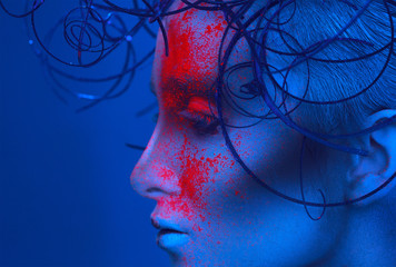 Profile portrait of sexy adult woman with powder on face