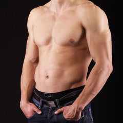 Young man showing his muscles