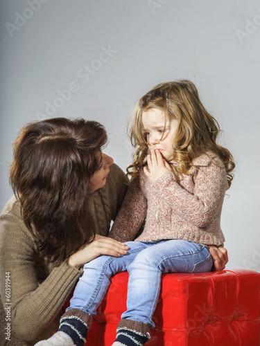 Mother reassuring little daughter