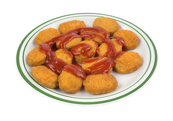 Chicken Nuggets On Green Striped Plate Side With Ketchup