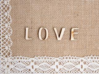 Word love on burlap