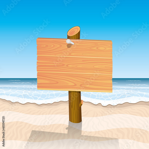 Wooden sign on beach.