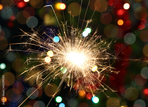 sparkler burning on festive background