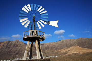 africa windmills and the sky in  isle of lanzarote