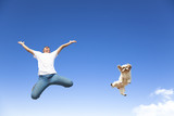 Fototapety young man and dog jumping in the sky