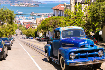 San Francisco Hyde Street and vintage car with Alcatraz