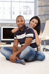 Happy mixed race couple at home