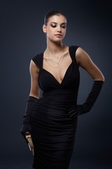 Woman in stylish black cocktail dress