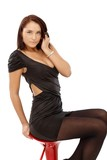 Sexy woman posing on barstool