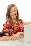 Portrait of attractive smiling woman with laptop