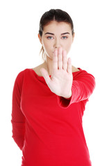 Hold on, Stop gesture showed by young woman