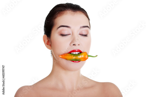 Beautiful woman with hot paprika