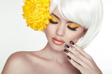 Beauty Blond Female Portrait with yellow flowers. Beautiful Spa