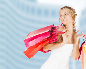 woman with shopping bags in dress