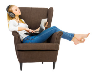 Young girl with headphones listen music on chair