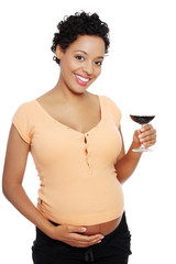 Pregnant woman holding glass wine