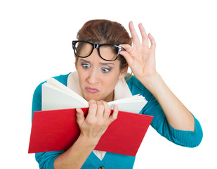 woman with eye glasses trying read book, having difficulties