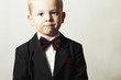 Fashionable Little Boy in Bow tie.Child in Black Suit